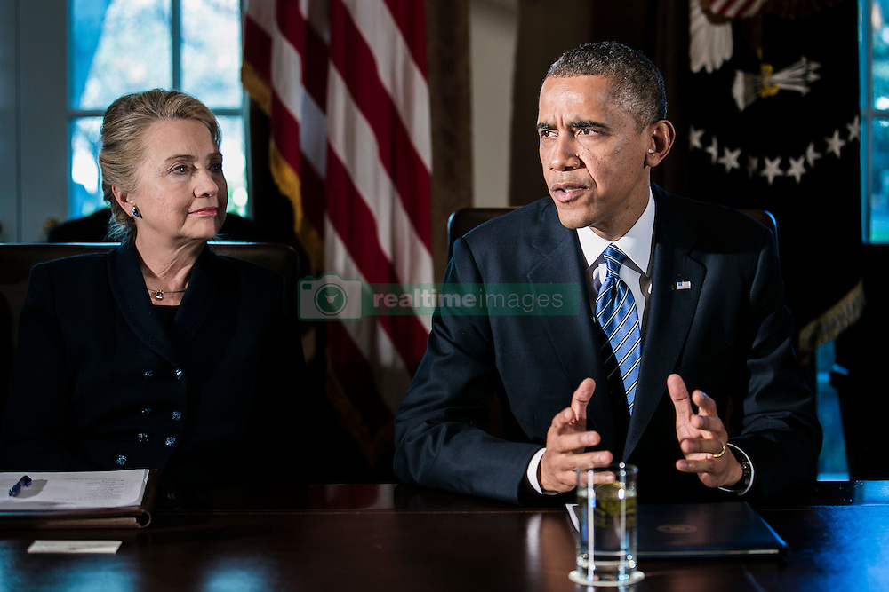 U.S. President Barack Obama, right, speaks as Department of State Secretary Hillary Clinton listens at a cabinet meeting at the White House in Washington, DC, USA on November 28, 2012. The president met yesterday with small business owners and today with the chief executives of major corporations in ongoing talks about the looming fiscal cliff. Photo by T.J. Kirkpatrick/Pool/ABACAPRESS.COM