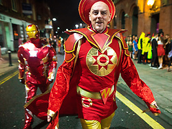 © Licensed to London News Pictures . 26/12/2017. Wigan, UK. Ming the Merciless . Revellers in Wigan enjoy Boxing Day drinks and clubbing in Wigan Wallgate . In recent years a tradition has been established in which people go out wearing fancy-dress costumes on Boxing Day night . Photo credit: Joel Goodman/LNP