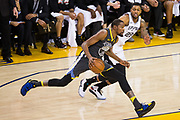 Golden State Warriors forward Kevin Durant (35) handles the ball against the San Antonio Spurs during Game 2 of the Western Conference Quarterfinals at Oracle Arena in Oakland, Calif., on April 16, 2018. (Stan Olszewski/Special to S.F. Examiner)