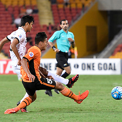BRISBANE, AUSTRALIA - FEBRUARY 21: Mongkol Tossakrai of Muangthong United's shot on goal is defended by Dane Ingham of the Roar during the Asian Champions League Group Stage match between the Brisbane Roar and Muangthong United FC at Suncorp Stadium on February 21, 2017 in Brisbane, Australia. (Photo by Patrick Kearney/Brisbane Roar)