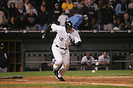 CHICAGO - OCTOBER 12:   AJ Pierzynski #12 of the Chicago White Sox strikes out but advances to first base after home plate umpire Doug Eddings ruled that Josh Paul trapped the ball and failed to tag Pierzynski in the 9th inning during Game 2 of the American League Championship Series against the Los Angeles Angels of Anahiem at U.S. Cellular Field on October 12, 2005 in Chicago, Illinois.   The White Sox defeated the Angels 2-1.