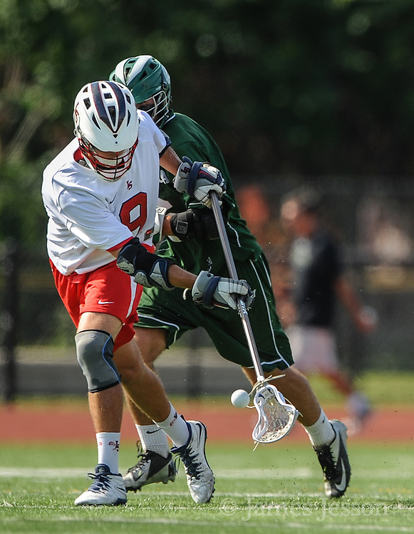 Lincoln-Sudbury Regional High School senior captain Eamon Hunter scoops up a loose ball during the Division 1 North Championship game against Billerica Memorial High School at Connolly Memorial Stadium in Woburn, June 13, 2015. The Warriors beat the Indians, 12-8.   (Wicked Local Photo/James Jesson)