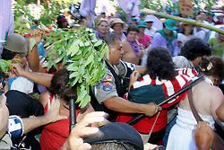 Marcha pelo Dia Internacional da Mulher reuniu mais  de 2 mil mulheres da Via Campesina e 3 mil pessoas do MST pelas ruas de Porto Alegre ate a PUC_RS, local onde acontece a II Conferencia Internacional sobre Reforma Agraria e Desenvolvimento Rural. Em frente a PUC houve pequeno confronto com a policia que depois  cedeu a invasao dos participantes no auditorio onde acontecia o evento da ONU.<br />  FOTO: Jefferson Bernardes/Preview.com