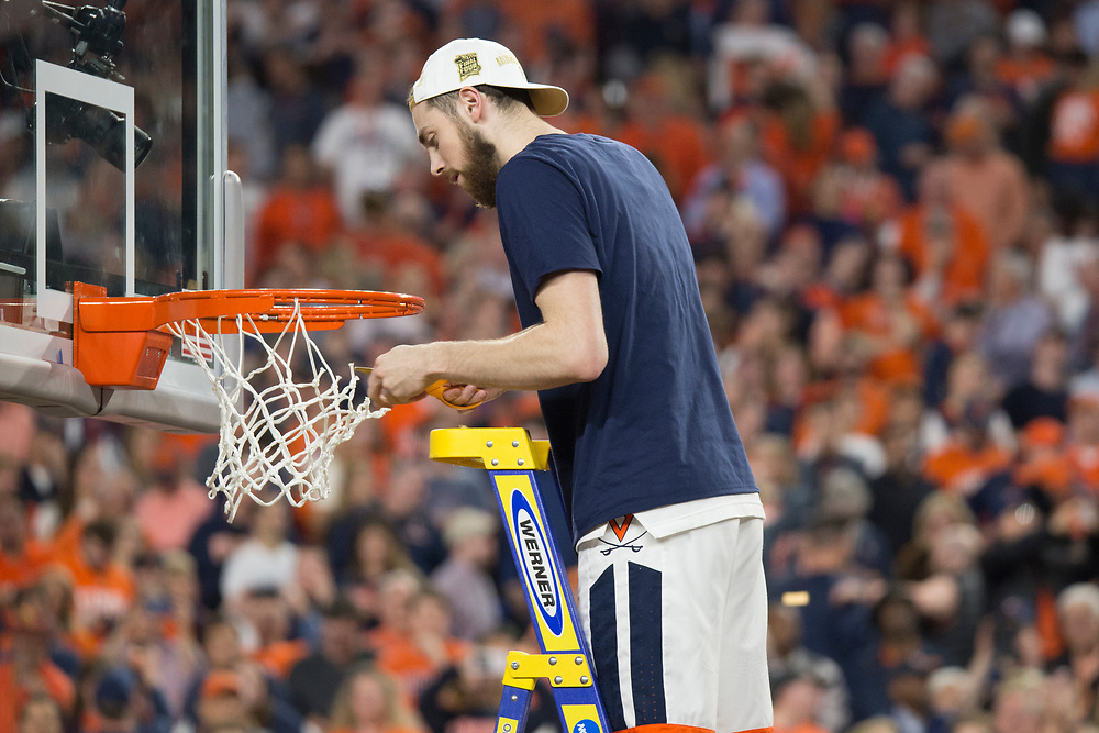 Jay Huff cutting down the net after Virginia wins the 2019 NCAA Men's Basketball National Championship on April 8, 2019.