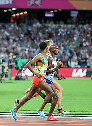 London, August 12 2017 . Muktar Edris, Ethiopia, Mo Farah, Great Britain and Andrew Butchart, Great Britain, lead the men's 5000m final on day nine of the IAAF London 2017 world Championships at the London Stadium. © Paul Davey.