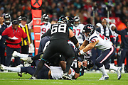 Jacksonville Jaguars quarterback, Gardner Minshew (15) is tackled by Houston Texan's outside linebacker, Dylan Cole (51) during the NFL game between Houston Texans and Jacksonville Jaguars at Wembley Stadium in London, United Kingdom. 03 November 2019