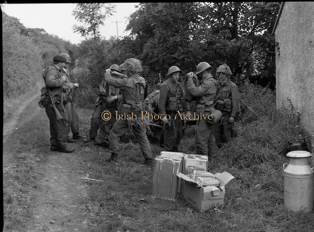 """Army Exercises In Co Sligo.   (L37).<br /> 1977.<br /> 05.09.1977.<br /> 09.05.1977.<br /> 5th September 1977.<br /> The Army Reserve Brigade, which is made up of regular units from the Southern Command, are conducting a series of conventional military exercises in counties Mayo and Sligo from the 5th to the 9th September. Approximately 1,500 men and 250 vehicles are involved. The exercise was codenamed """"Humbert"""" after an ill fated expedition by French troops into Ireland on 23rd August 1798. 1,100 French troops with Irish support took on the incumbent English forces. After some initial success they were defeated at Ballinamuk on 8th Sept 1798 by the army of Cornwallis.<br /> <br /> Image of an artillery crew as they move their mortar into position for the forthcoming assault."""