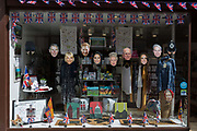 Face masks of the royal family in a shop window as the royal town of Windsor gets ready for the royal wedding between Prince Harry and his American fiance Meghan Markle, on 14th May 2018, in London, England.