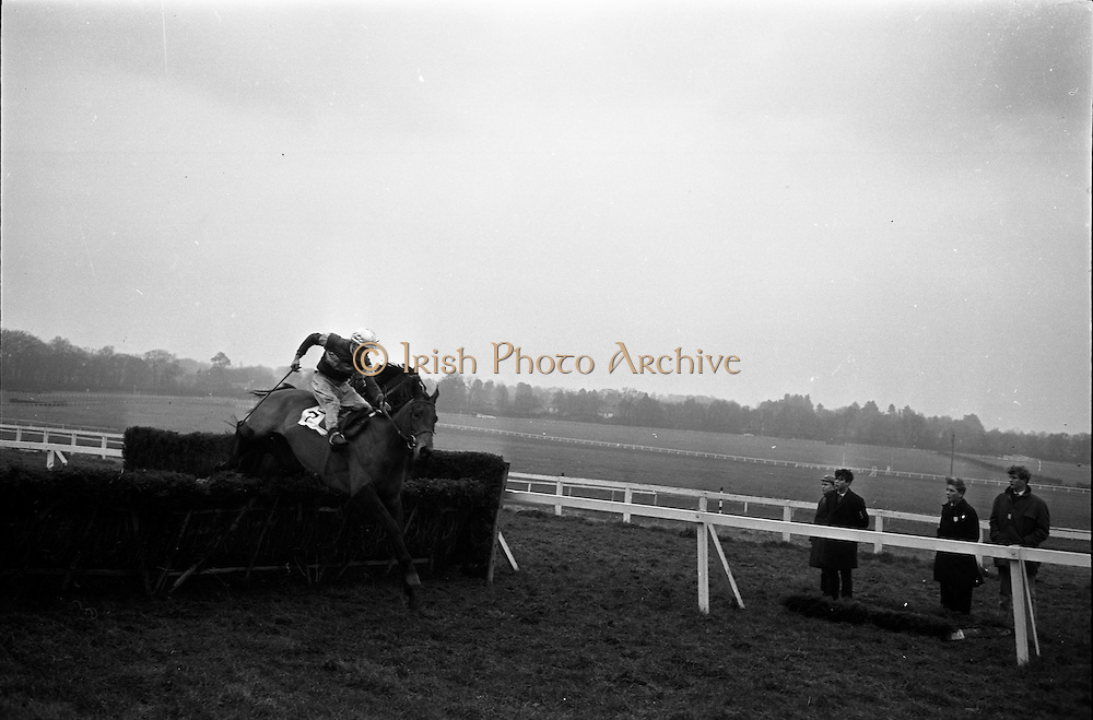 """16/01/1963<br /> 01/16/1963<br /> 16 January 1963<br /> Leopardstown Races at Leopardstown Race track, Dublin. A.H. watt's """"Dance  On"""" (7), ridden by J.J. Rafferty clearing the last hurdle in front of Mrs J.A. McAllister's """"Jungle Trix"""" (F. Carroll up) in the Ticknock Handicap Hurdle Races. """"Dance ON"""" went on to win the race."""