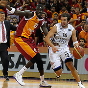 Galatasaray's and Boniface Ndong (L) Anadolu Efes's Kerem Tunceri (R) during their BEKO Basketball League match Galatasaray between Anadolu Efes at the Abdi Ipekci Arena in Istanbul at Turkey on Sunday, February 17, 2013. Photo by Aykut AKICI/TURKPIX
