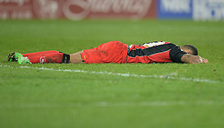 Bournemouth's Callum Wilson lays head down on the grass after the final whistle. - Photo mandatory by-line: Alex James/JMP - Mobile: 07966 386802 - 17/03/2015 - SPORT - Football - Cardiff - Cardiff City Stadium - Cardiff City v AFC Bournemouth - Sky Bet Championship