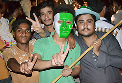 June 18, 2017 - Hyderabad, Sindh, Pakistan - Pakistani youngsters showing victory sign after Pakistan wins there final match against India here on Hyderabad on June 18. (Credit Image: © Janali Laghari/Pacific Press via ZUMA Wire)