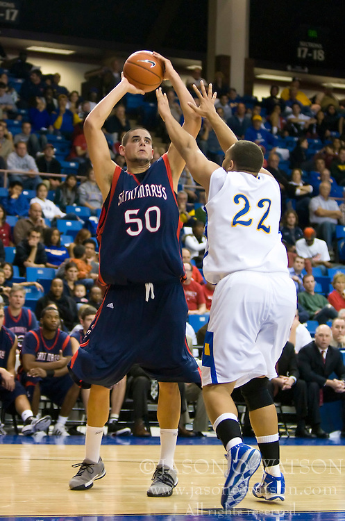 November 30, 2009; San Jose, CA, USA;  Saint Mary's Gaels center Omar Samhan (50) shoots over San Jose State Spartans forward C.J. Webster (22) during the second half at the Event Center Arena.  Saint Mary's defeated San Jose State 78-71.