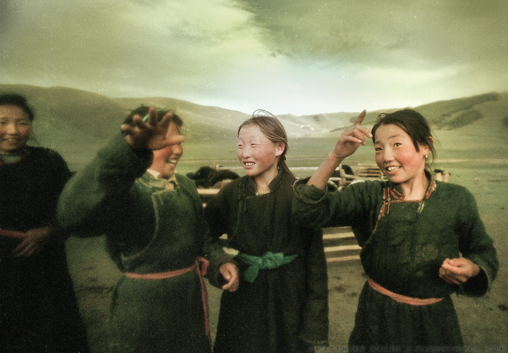 """Young Mongolian girls amazed at the rare sight of a foreigner. Young kids usually milk the family yaks every evening. Near Zagastain Davaa, the """"Fish Pass"""" in Zavkhan Aimag. Mongolia."""