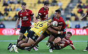 Crusaders Will Jordan is tackled by Hurricanes Asafo Aumua. Super Rugby Aotearoa. Hurricanes v Crusaders, Sky Stadium, Wellington. Sunday 11th April 2021. Copyright photo: Grant Down / www.photosport.nz