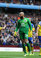 Everton keeper Tim Howard celebrates after he saves a 1st half penalty taken by Aston Villa's Christian Benteke. Barclays Premier League, Aston Villa v Everton at Villa Park in Aston, Birmingham on Saturday 26th Oct 2013. pic by Andrew Orchard, Andrew Orchard sports photography,