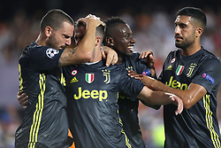 September 19, 2018 - Valencia, Spain - Miralem Pjanic of Juventus FC celebrates with his teammates after scoring his side's opening goal during the UEFA Champions League, Group H football match between Valencia CF and Juventus FC on September 19, 2018 at Mestalla stadium in Valencia, Spain (Credit Image: © Manuel Blondeau via ZUMA Wire)