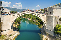 MOSTAR, BOSNIA - AUGUST 2016: People at Old Bridge over Neretva river in Mostar, Bosnia and Herzegovina.