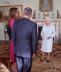 Queen Elizabeth II in conversation with Queen Rania of Jordan, King Abdullah II of Jordan and Crown Prince Hussein of Jordan during a private audience at Buckingham Palace, London.