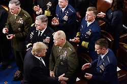 U.S. President Donald J. Trump checks hands with military officials before delivering his first address to a Joint Session of Congress on Tuesday, February 28, 2017 at the Capitol in Washington, DC. Photo by Olivier Douliery/ Abaca