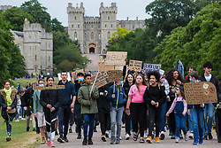 Windsor, UK. 4th June, 2020. Hundreds of young people take part in a peaceful protest march in solidarity with the Black Lives Matter movement. The march, along the Long Walk in front of Windsor Castle, was organised at short notice by Jessica Christie at the request of her daughter Yani, aged 12, following the death of George Floyd while in the custody of police officers in Minneapolis in the United States.