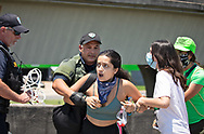 Woman being arrested on the off ramp of the West Bank Expressway. durring a protest against the police in Harvey Louisana on June 16, 2020. The protest organized by the families of Modesto Reyes, Keeven Robinson, Darivi Robertson,Chris Joseph, Armond Jairon Brown Eric Harris and Leo Brooks - black men killed by the Jefferson Parish Police since 2018. He was one of 5 people arrested. at the protest where family members are calling for accountability from the Jefferson Parish Sheriff's Office and for the officers to be required to wear body cameras.