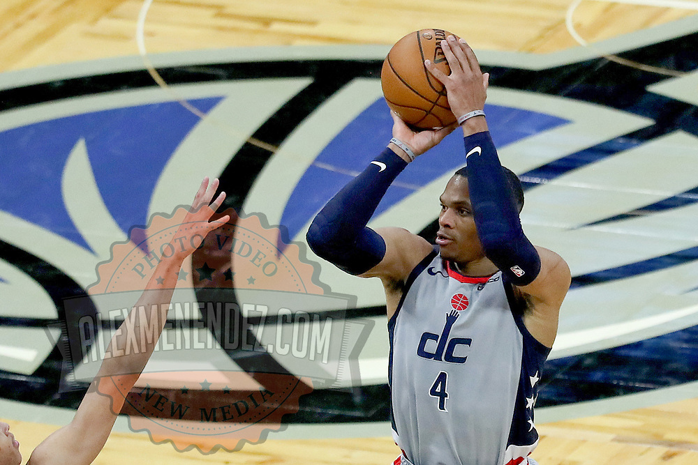ORLANDO, FL - APRIL 07: Russell Westbrook #4 of the Washington Wizards attempts a shot against the Orlando Magic during the second half at Amway Center on April 7, 2021 in Orlando, Florida. NOTE TO USER: User expressly acknowledges and agrees that, by downloading and or using this photograph, User is consenting to the terms and conditions of the Getty Images License Agreement. (Photo by Alex Menendez/Getty Images)*** Local Caption *** Russell Westbrook