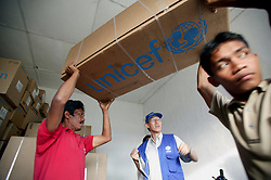 At a Banda Aceh provincial health office close to the airport UNICEF health kits have been stored after their airfreight arrival.  They are now being delivered to NGO partners running medical clinics and government clinics and hospitals. Budi Subianto from the health section of UNICEF Jakarta supervises