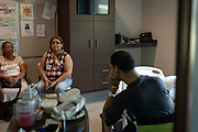 Angel Santiago in his room at HealthSouth Rehabilitation Hospital during a visit with his mother Gloria Santiago (C) and grandmother Maria Diaz in Altamonte Springs, Florida, U.S.