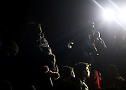 Migrants engage in a stand off with police close to the Hungarian and Serbian border town of Roszke, Hungary, September 8 2015. The UN's humanitarian agencies are on the verge of bankruptcy and unable to meet the basic needs of millions of people because of the size of the refugee crisis in the Middle East, Africa and Europe, senior figures within the UN have told the media.