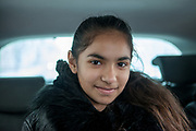 """Portrait of Rachel Klemparova (9) in the car on the way home from school. Rachel visits the 4th class at the """"Nadrazni"""" school in Ostrava where Roma and non Roma children are educated together."""