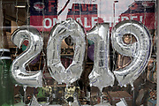 2019 balloons on display in a party shop on Kensington High Street, on 6th january 2019, in London, UK