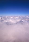 Clouds in a blue sky taken from an aerial perspective.