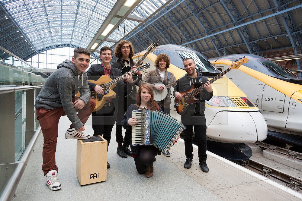 """© Licensed to London News Pictures. 04/04/2013. London, England. The winners of the 2012 busking competition run by the Mayor of London, the six-piece folk-rock band """"Jamie Thorn and the Mystery Pacific"""", play to passengers at St. Pancras International before embarking on a trip to Paris for a day's busking on the Eurostar.  Photo credit: Bettina Strenske/LNP"""