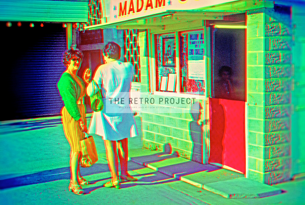 Vintage women talking outside palm reader booth with vivid mis-registered colour