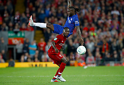 Liverpool's Naby Keita and Chelsea's Victor Moses battle for the ball during the Carabao Cup, Third Round match at Anfield, Liverpool.
