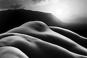 Black and white photographic bodyscape of man and earth