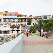 People enjoying the waterfront boardwalk in Casco Viejo in Panama City, Panama.