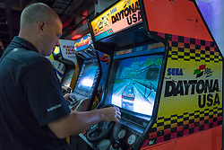 © Licensed to London News Pictures. 12/08/2018. LONDON, UK. A man plays Sega Daytona USA, a nineties driving game, at Play Expo London, a video games show featuring consoles, handhelds, computers, vintage arcades and pinball machines, organised by Replay Events taking place at the Printworks in Canada Water, East London.  Photo credit: Stephen Chung/LNP