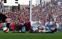 Photo: Olly Greenwood.<br />West Ham United v Newcastle United. The Barclays Premiership. 17/09/2006. Newcastle United's Shay Given and West Ham's Marlon Harewood lies injured
