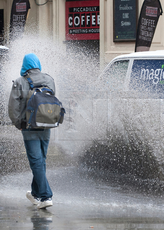 © licensed to London News Pictures. London, UK 11/06/2012. A car splashes water from a puddle onto pedestrian during heavy rain in Piccadilly Circus, London, today (11/06/12). Photo credit: Tolga Akmen/LNP