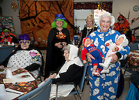 "Having newborn ""twins"" didn't stop Gemma Hamel from attending the Laconia Senior Center's Halloween festivities and luncheon on Thursday.   (Karen Bobotas/for the Laconia Daily Sun)"