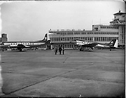 """21/01/1956<br /> 01/21/1956<br /> 21st January 1956<br /> Aer Lingus special - aircraft with new markings, the Vickers Viscount 700 """"Breandán"""" and the DC3 """"Colmcille"""", in front of the terminal at Dublin Airport."""