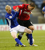Photo: Steve Bond/Richard Lane Photography. Leicester City v Swansea City. FA Cup Third Round. 02/01/2010. Jordi Lopez (R) is tackled by Ryan McGivern