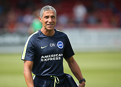 Brighton Manager Chris Hughton prepares for kick off during a pre season friendly match at The Cherry Red Records Stadium, Kingston Upon Thames.