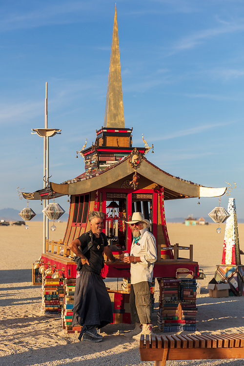 The Larry Memorial<br /> by: Dana Albany, Andrew Johnstone, David Best, Flash Hopkins<br /> from: San Francisco, CA<br /> year: 2019<br /> <br /> A stepped pyramid crowned with a palanquin and large spire, flanked on each corner by lamplighter spires.<br /> It serves as a physical representation of Larry's mind palace and contains some of Larry's books and mementos.<br /> <br /> Contact: danaalbany@juno.com My Burning Man 2019 Photos:<br /> https://Duncan.co/Burning-Man-2019<br /> <br /> My Burning Man 2018 Photos:<br /> https://Duncan.co/Burning-Man-2018<br /> <br /> My Burning Man 2017 Photos:<br /> https://Duncan.co/Burning-Man-2017<br /> <br /> My Burning Man 2016 Photos:<br /> https://Duncan.co/Burning-Man-2016<br /> <br /> My Burning Man 2015 Photos:<br /> https://Duncan.co/Burning-Man-2015<br /> <br /> My Burning Man 2014 Photos:<br /> https://Duncan.co/Burning-Man-2014<br /> <br /> My Burning Man 2013 Photos:<br /> https://Duncan.co/Burning-Man-2013<br /> <br /> My Burning Man 2012 Photos:<br /> https://Duncan.co/Burning-Man-2012