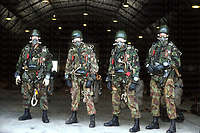 Members of the elite airborne Pathfinders before a high altitude low opening (HALO) jump. They are equipped with SA80 rifles alongside oxygen respirators and altimeter watches. 1990 photograph by Terry Fincher