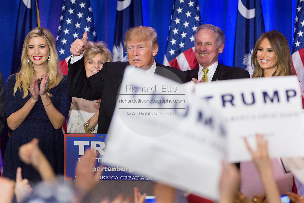 Billionaire and GOP presidential candidate Donald Trump gives a thumps up to cheering supporters alongside wife Melania, daughter Ivanka and Lt. Gov. Henry McMasters as they celebrate victory in the South Carolina Republican primary February 20, 2016 in Spartanburg, South Carolina, USA .