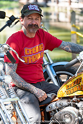 Slinging Ink tattoo artist Oliver Peck at the Born-Free Vintage Motorcycle show at Oak Canyon Ranch, Silverado, CA, USA. Sunday, June 23, 2019. Photography ©2019 Michael Lichter.