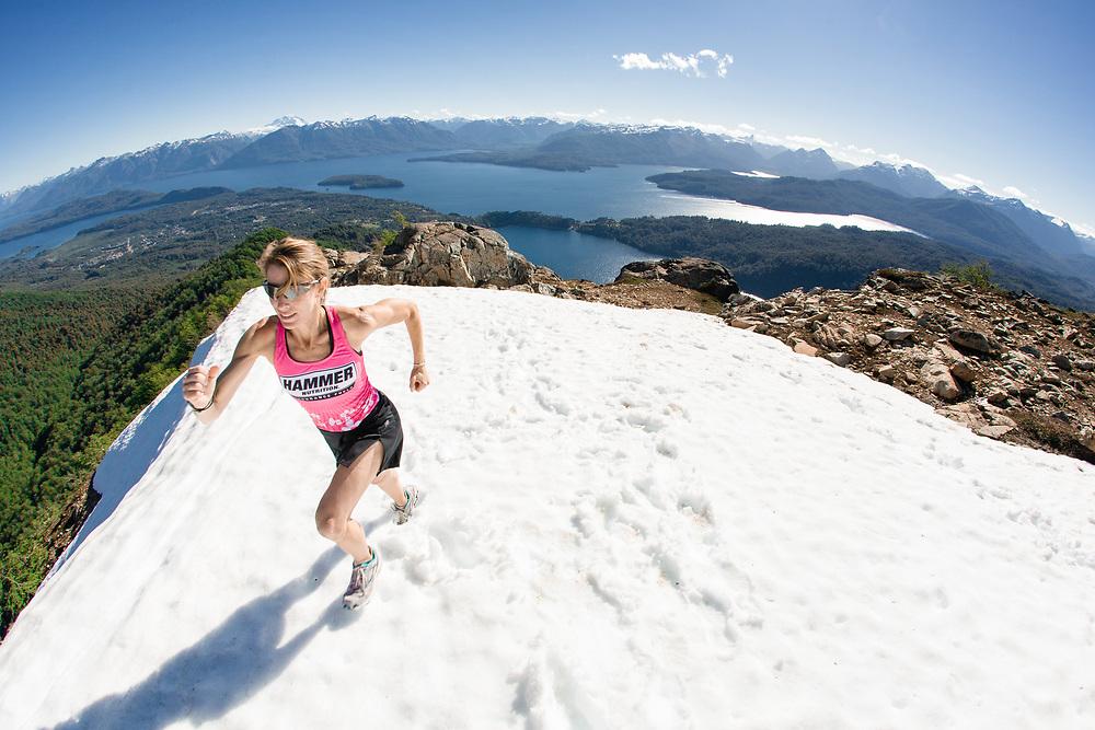 Amanda McIntosh running at the summit of a snowed peak in Villa La Angostura, Neuquén, Patagonia Argentina.<br /> Client/Project: Hammer Nutrition / Amanda McIntoch